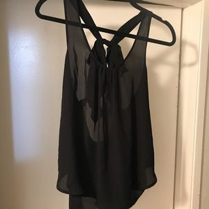 Cute black blouse with a bow on the back